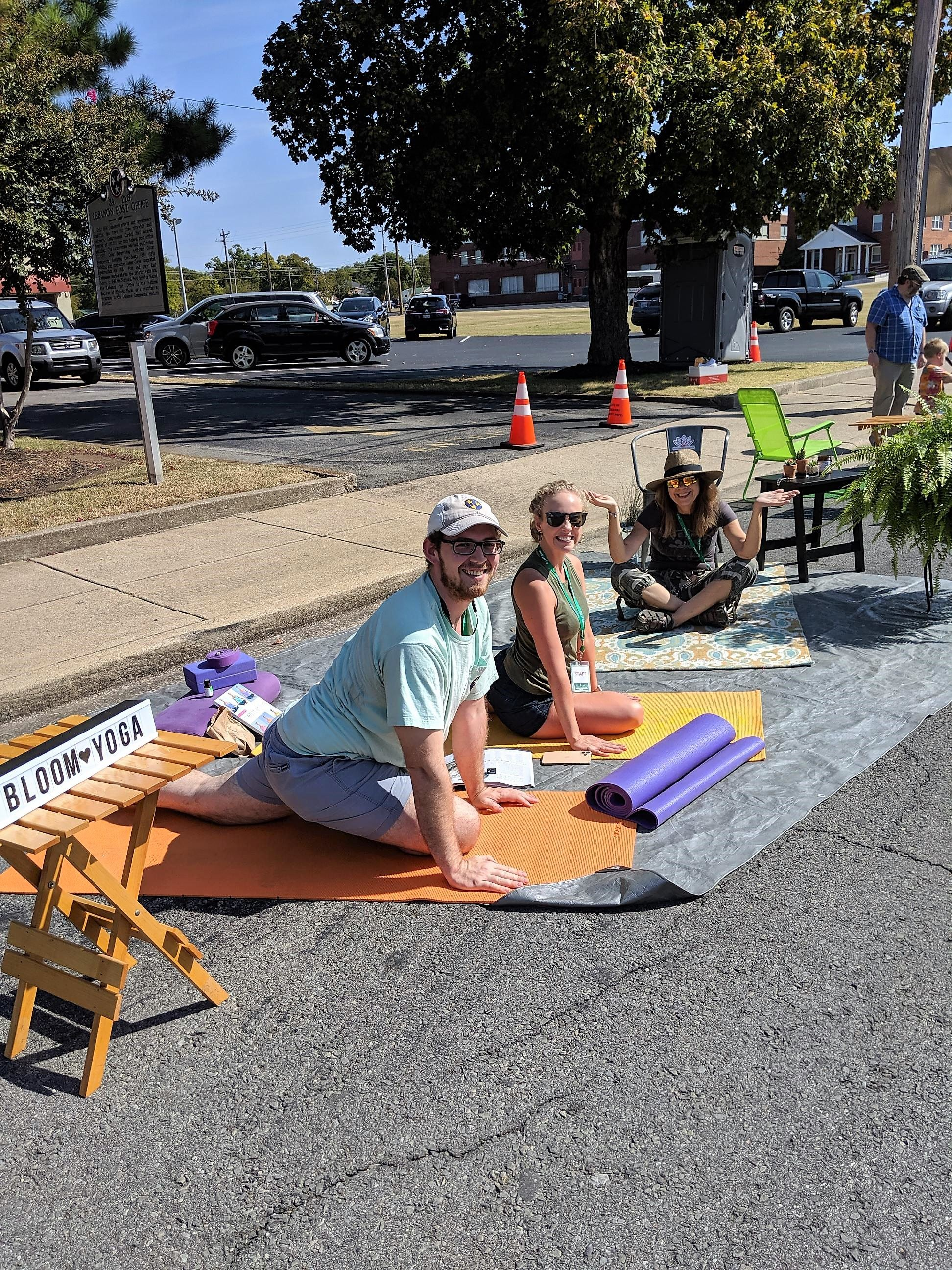 People streching and doing yoga in the Bloom Yoga Parklet.