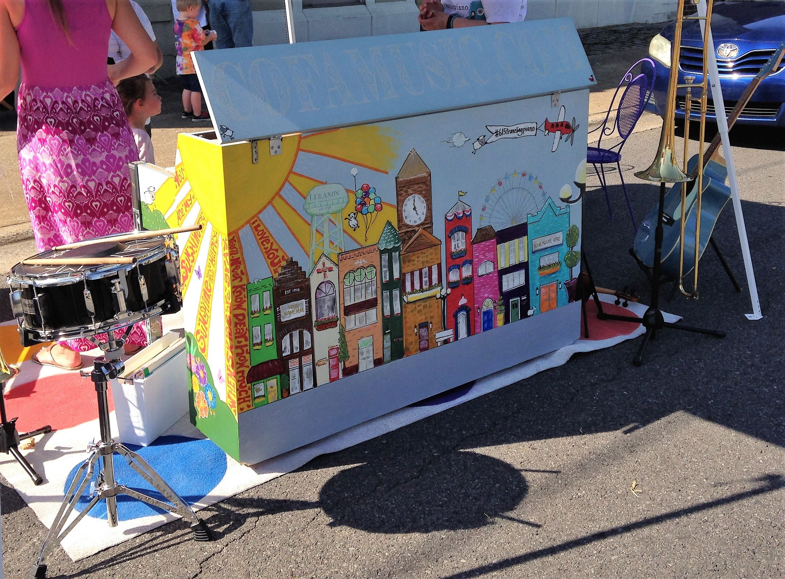 Close up of the traveling piano with painted fun images of lebanon buildings.